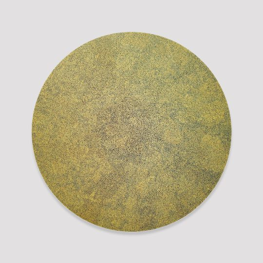 Extra fine gold scribble filling a black circle