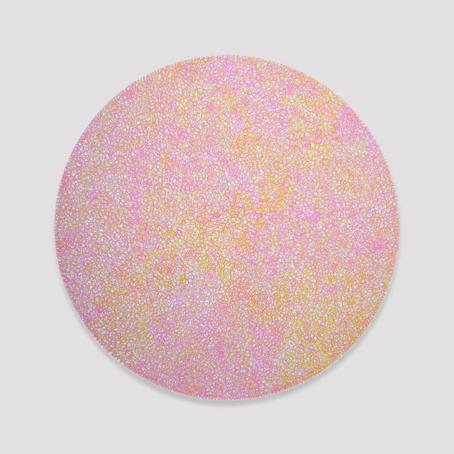 Medium pink and yellow scribbles filling a white circle