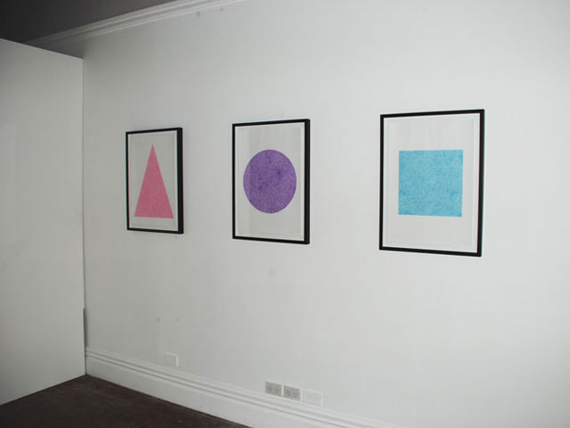 Pink scribble filling a white triangle, Purple scribble filling a white circle, Cyan scribble filling a white square